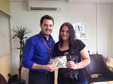 André Machado (gerente filial Curitiba) e Cintia Ferreira (recuperadora premiada filial Curitiba - equipe Sofisa)