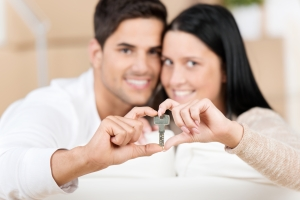 Happy young couple holding their new house key